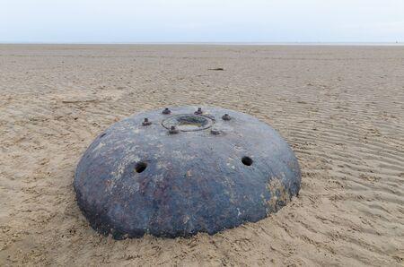ww1: big metal world war underwater contact mine on a beach Stock Photo
