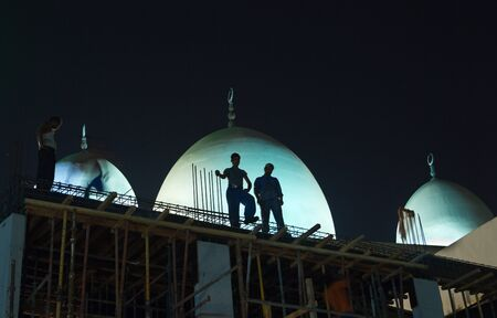 construction workers working in the middle of the night in deira, dubai untied arab emirates