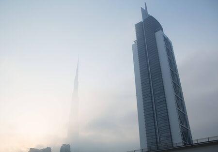 sheik: The burj Khalifa covered in mist shot from sheik zayed road