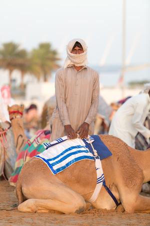 saddle camel: Dubai camel racing club camel and young keeper.