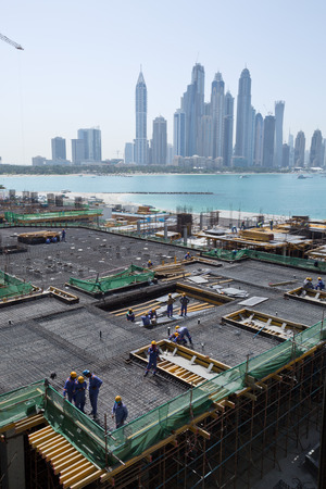 viceroy: Viceroy Hotel development building site on the Palm, Dubai, with Dubai Marina skyline in the background Stock Photo
