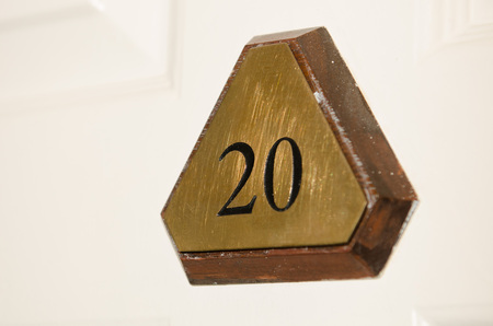 hotel room door: Metal number 20 triangular hotel room door sign