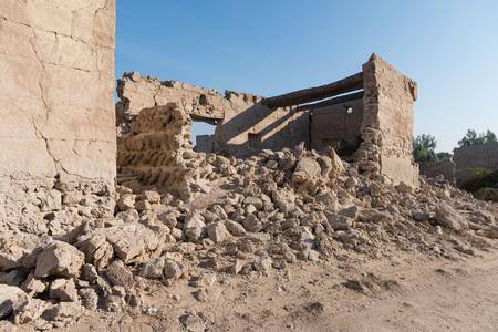 al: Coral house and broken wall, Old Ras Al Khaimah abandoned ghost town, Al Jazirah Al Hamra