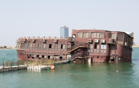 al: Sinking boat restaurant in Ras Al Khaimah