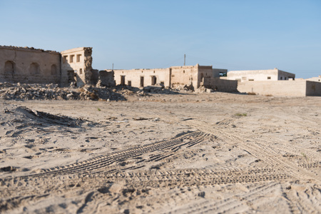 al: Tyre tracks at Old Ras Al Khaimah abandoned ghost town, Al Jazirah Al Hamra