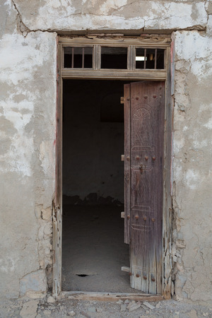 ras: Traditional weathered wooden door frame, Old Ras Al Khaimah abandoned ghost town, Al Jazirah Al Hamra