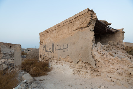 ghost town: Traditional house ruin made of sand and coral, Old Ras Al Khaimah abandoned ghost town, Al Jazirah Al Hamra Stock Photo