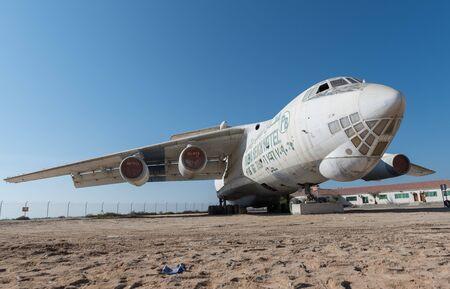 airfield: abandoned Soviet cargo plane left in the desert in Umm Al Quwains unused airfield