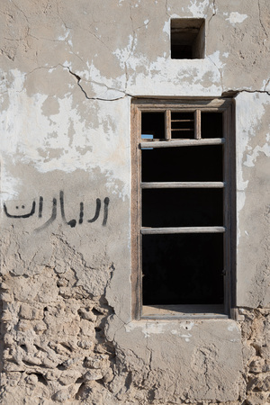 ras: Wooden window frame ruin,Old Ras Al Khaimah abandoned ghost town, Al Jazirah Al Hamra Stock Photo