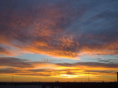 shepards: Fiery sunset sky with Beautiful pink dark fluffy clouds clouds
