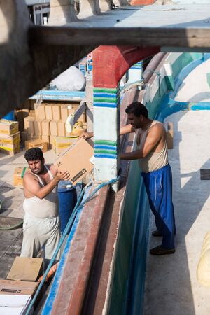 bur dubai: Syrian cargo ship workers delivering goods Editorial
