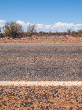markings: Australian outback road markings and blue sky Stock Photo