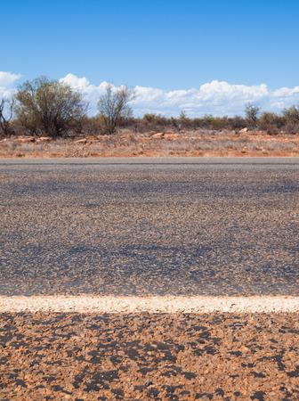 australian outback: Australian outback road markings and blue sky Stock Photo