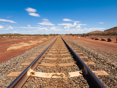the outback: Australia, Northern territory, 05212014, Outback railroad crossing disappearing into the horizon.