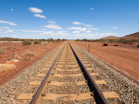 wildwest: Australia, Northern territory, Outback railroad crossing disappearing into the horizon. Stock Photo