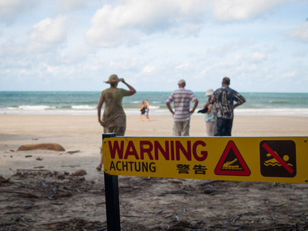 no swimming: Australia, Broome, Crocodile beach, no swimming warning sign. Crocodiles in sea.
