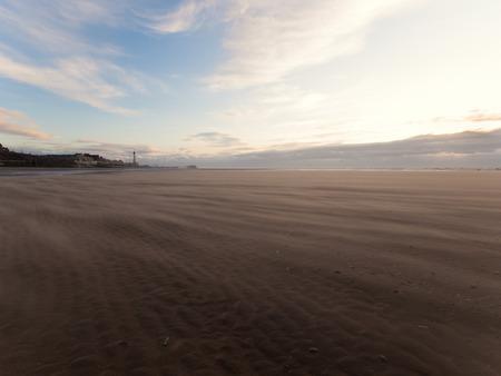 refelction: England, Blackpool, 04222015, Windy sandstorm on blackpool beach