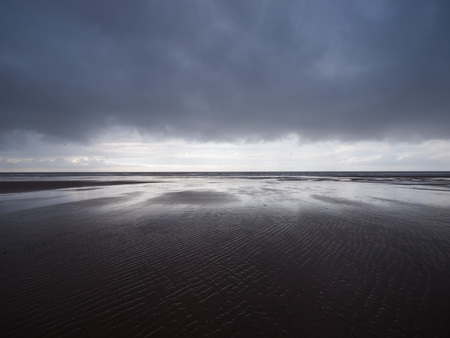 miserable: England, Blackpool, Overcast miserable blackpool beach landscape