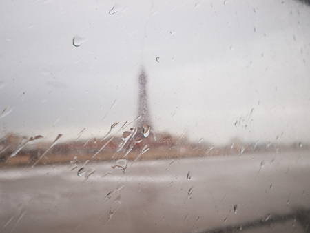 miserable: England, Blackpool, 04222015, Blackpool tower shot through glass on a miserable windy wet day