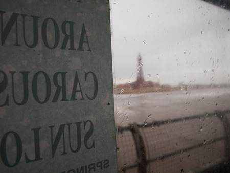 miserable: England, Blackpool, Blackpool tower shot through glass on a miserable windy wet day