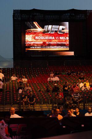 punch press: United Arab Emirates, Abu Dhabi, 04112014, UFC fight night ,  Abu Dhabi, Nogueria vs Nelson digital screen and crowd.