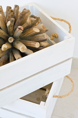 feature: Cream and white wooden crate with driftwood feature Stock Photo
