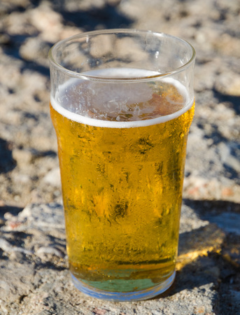 unwind: A cold pint of refreshing beer in a sunny hot environment