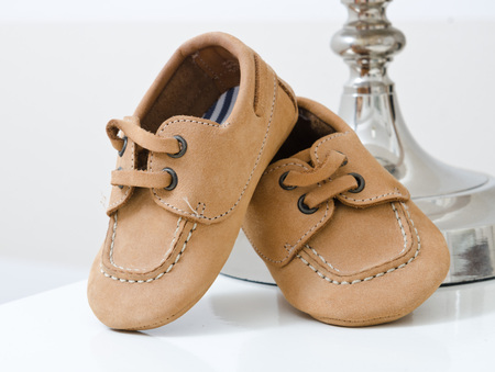 sneaks: Baby leather shoes on a white background