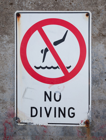 no diving sign: weathered no diving sign