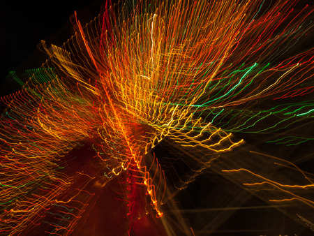 trails of lights: Multicoloured warm lights forming radial starburst light trails