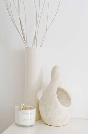 features: Cream and white ceramic features with vanilla incense candles burning Stock Photo