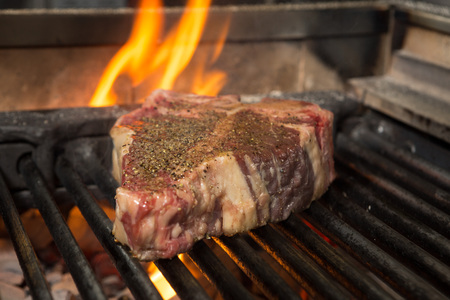 t bone: T Bone being flame grilled to perfection