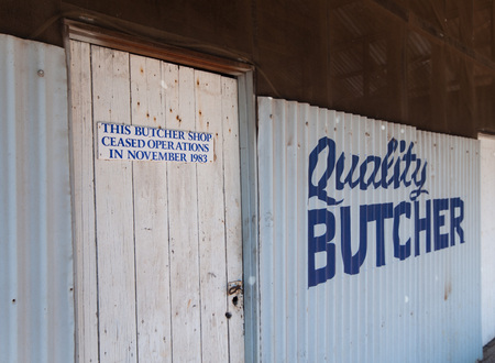 tucker: Western Australia, Australia, 08082015, Old abandoned hand painted butchers shop sign in a small outback town