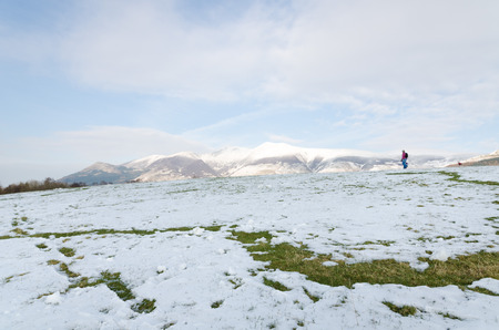 ramble: The Lake District, Keswick, England, 01172016, Snowy field with snow covered mountains in the background