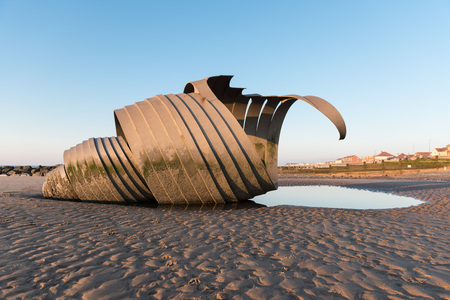 progressive art: Cleveleys, England, 01222016, Huge metal sea shell conch sculpture on the beach at sunset