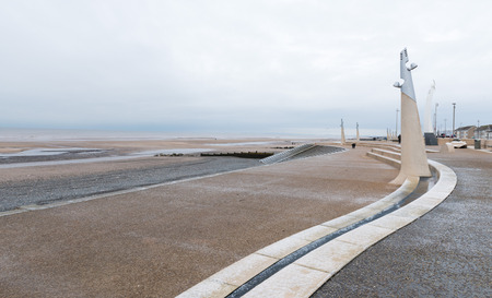 stone cold: Cleveleys, England, 01172016, Icy cold promenade leading down to a beach on a gloomy winters day Stock Photo