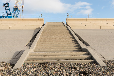 bannister: concrete beach steps going up, shot from below.