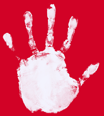 hand print: ink hand print on red paper