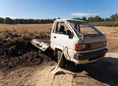 drop off: Western australia, Australia, 02102016, old Toyota Townace mini van delivering soil and plants for composting