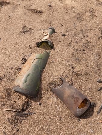 Cracked and melted glass bottles in the Australian outback after a bush fire.