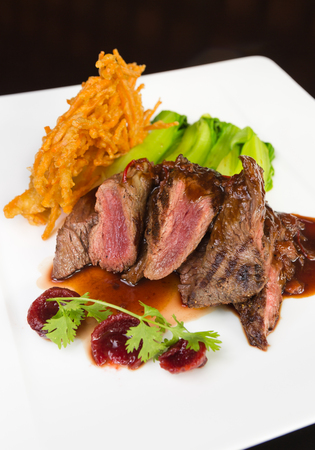 skippy: Flame grilled ,rare kangaroo steak loin, served with pak choi and a red wine sauce