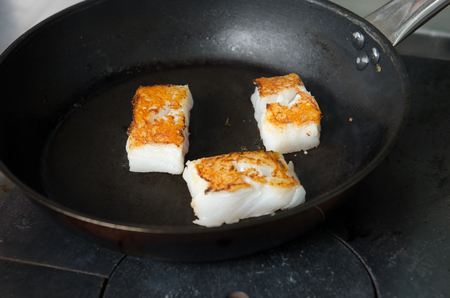 chippy: Pan fried golden fish fillet cubes, frying in real butter, in a non stick rustic pan.