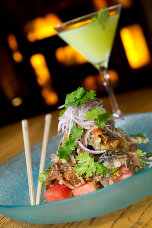 tangy: king crab tempura, served with red onion, watermelon, garnish and finished off with a drizzle of tangy amazu ponzu sauce Stock Photo
