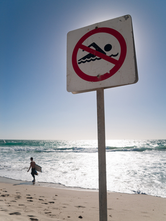 no swimming sign: Perth, Australia, 04042014, Cottesloe Beach, Western australia, No Swimming sign and rough waves.