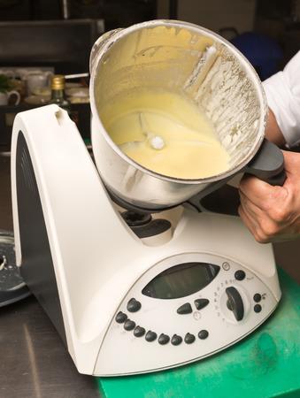 An industrial restaurant kitchen blender machine.