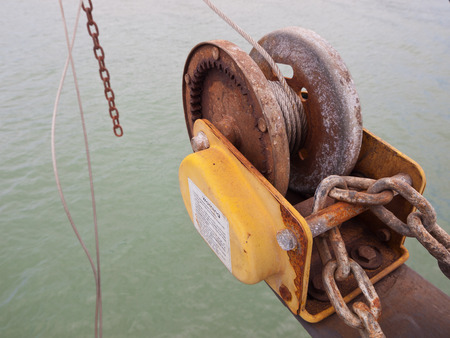 fishing rig: A well used rusty fishing winch on an industrial fishing boat,