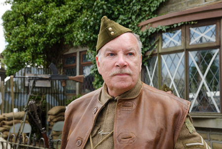 take a history: Yorkshire, England, 05152015, An older british war veteran soldier with a beret hat. Howarth 1940s weekend Editorial