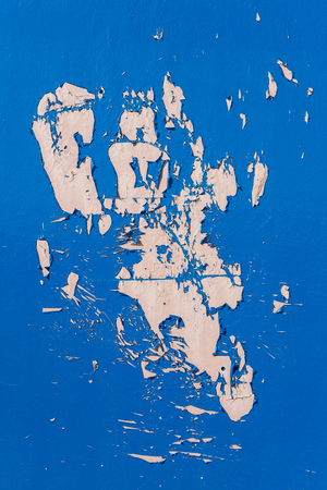 exfoliate: Blue dry peeling crackling chipped paint textured wall