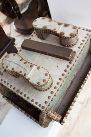 foot ware: A rustic old antique leather shoe shine box. Stock Photo