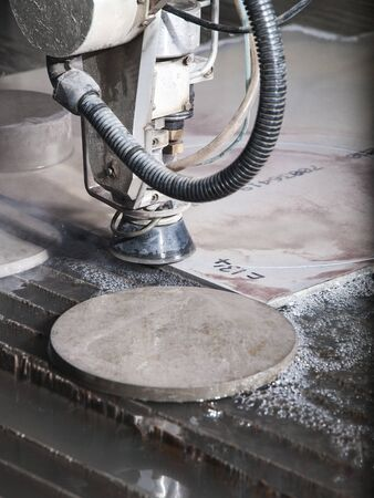 cutting through: water pressure cutting machine cutting through stainless steel materials Stock Photo